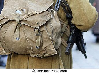 machine gun rifle of a WWII soldier in uniform - dangerous...