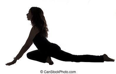 Pigeon Pose in Yoga, Silhouette - Young woman is doing...