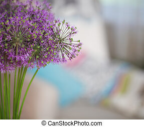 Chinese Chive flowers in the flower vase on table in the...