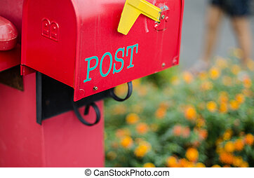 Box mail post with flower background.
