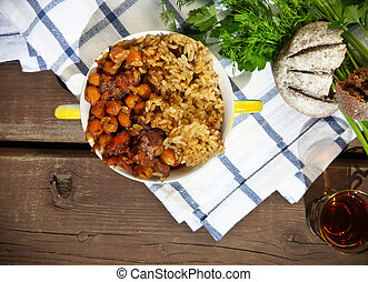 Uzbek national dish plov in a bowl on the table