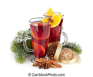 Christmas mulled wine with spices and snowy fir tree...