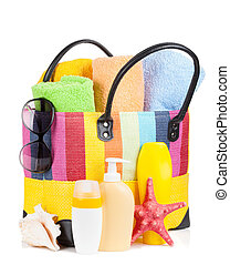 Bag with towels, sunglasses and beach items