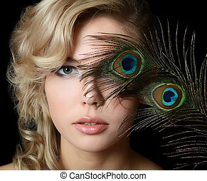 The beautiful woman with feathers of a peacock - The...