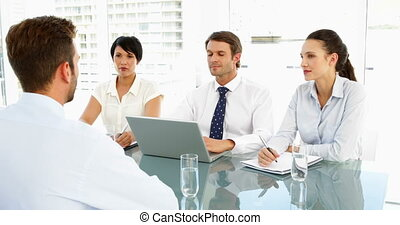 Interview panel explaining to applicant in the office