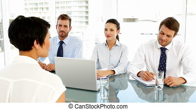 Interview panel talking to applicant in the office