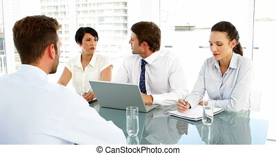 Smiling interview panel talking to applicant in the office