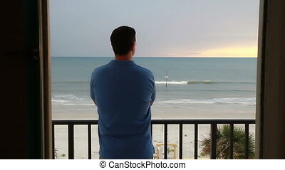 Man looking out over the ocean Daytona Beach Florida