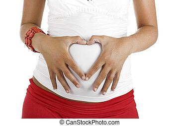Pregnancy - Beautiful pregnant woman with her hands on the...