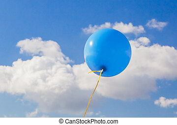 Blue Balloon - A blue helium balloon with a yellow ribbon...