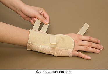 woman's hand with carpal tunnel syndrome remove the wrist...