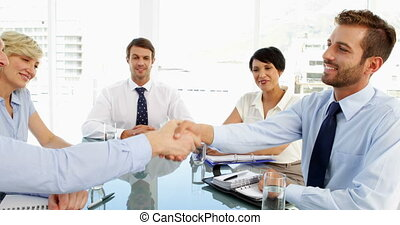 Business people shaking hands at a meeting in the office