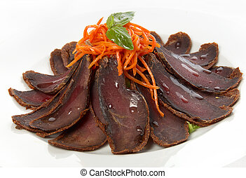 The beef meat dried on plate
