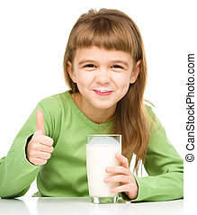 Cute little girl showing milk moustache and thumb up sign,...