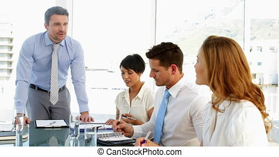 Businessman talking to his staff