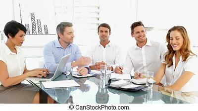 Happy business team discussing duri