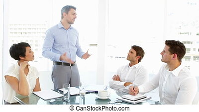Boss storming off in anger during meeting in the office