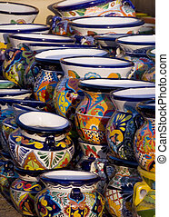 Mexican Pottery at Sunset - Stacks of Colorful Mexican...