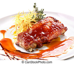 pork ribs in barbecue sauce with potato
