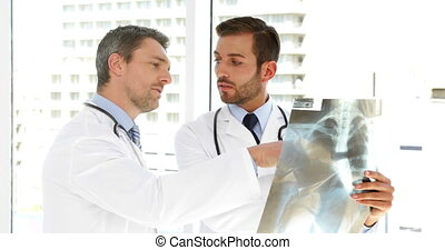 Serious doctors studying an xray at the hospital