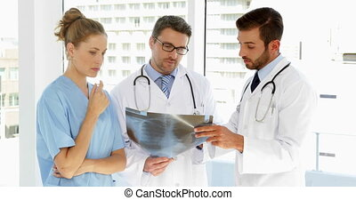 Medical team discussing xray at the hospital