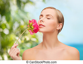 lovely woman with peonie flower - health and beauty concept...