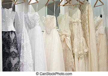 Bridal shop with wedding dresses on hangers