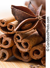 Dry multicolored spice closeup on wooden background