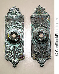 twin doorbells - pair of tarnished, ornate carved brass...