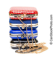 Fashionable female handbags on white background