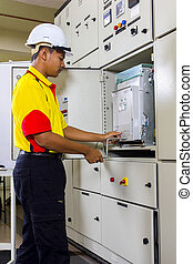 electrician at work on main switch board