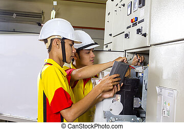 two electrician at work