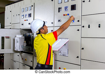 young electrician at work on distribution board