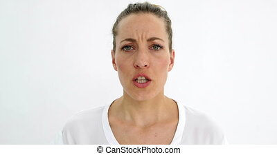 Annoyed woman shouting at camera on white background