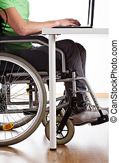 Disabled student during class - Student on wheelchair during...