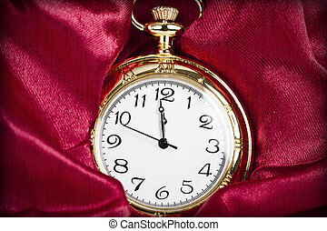 Gold pocket watch - Old styled gold pocket watch on scarlet...
