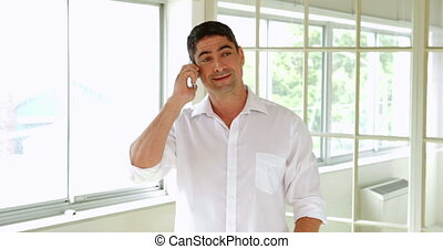 Cheerful man making a phone call
