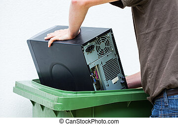 Throwaway old computer - Men throwaway hardware into...