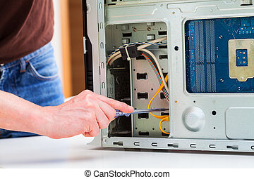 Pc repair - Computer specialist use screwdriver to repair...