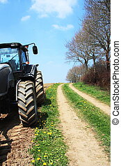 Lunch Break - A tractor stands ina ploughed field alongside...