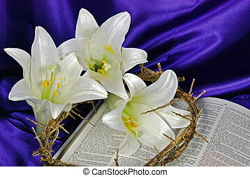 Easter Sunday - Easter lily blooms and crown of thorns on a...