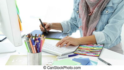 Concentrated creative designer sketching ideas in creative...