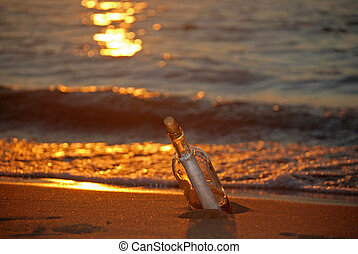 Intrigue At Sunset - Message in a bottle on the beach at...