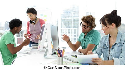 Four creative designer working together in creative office
