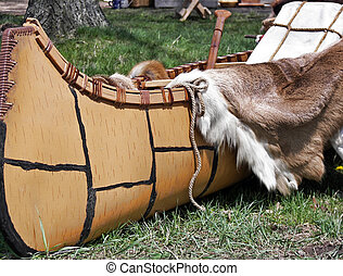 Indian Trade - Indian canoe filled with fur pelts.