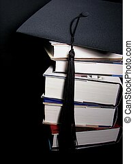 Graduation From Education - Graduation cap on a stack of...