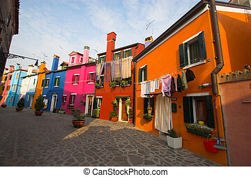 Street of Burano - Brightly colored buildings and laundry...