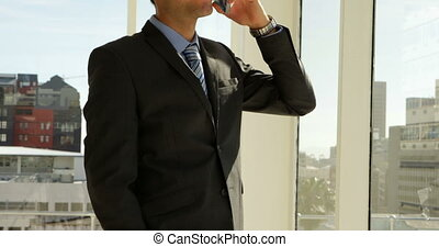 Businessman looking out his window