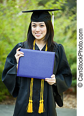 Graduation girl - A happy beautiful graduation girl holding...