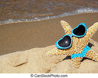 Beach Babe - Starfish wearing a bikini and sunglasses on the...